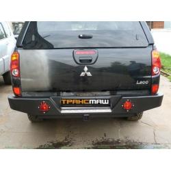 Задний бампер Mitsubishi L200